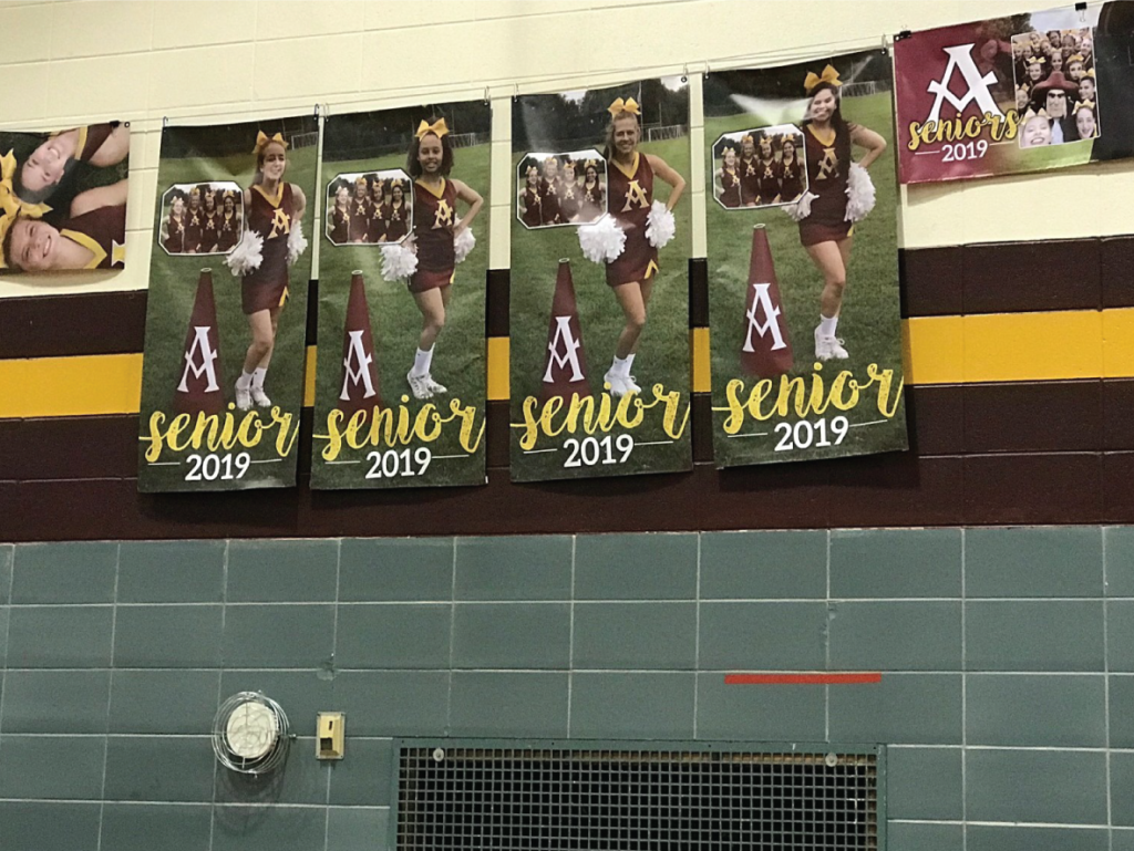 gym poster banners high school cheerleaders