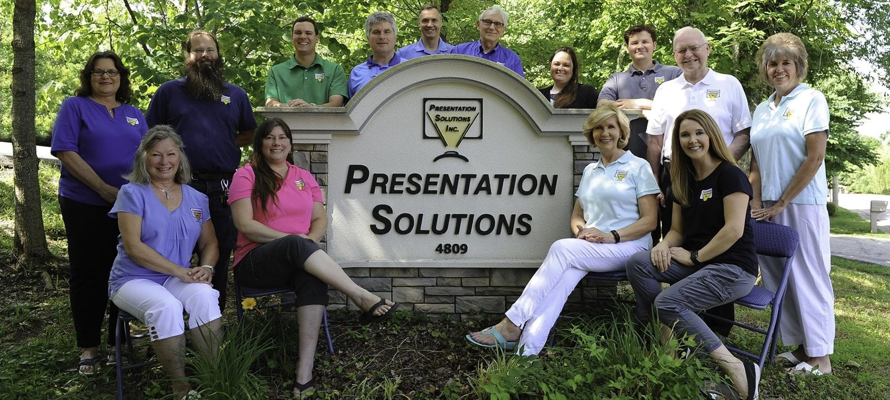 Presentation Solutions' Team Standing outside their office ready to supply poster makers for schools.