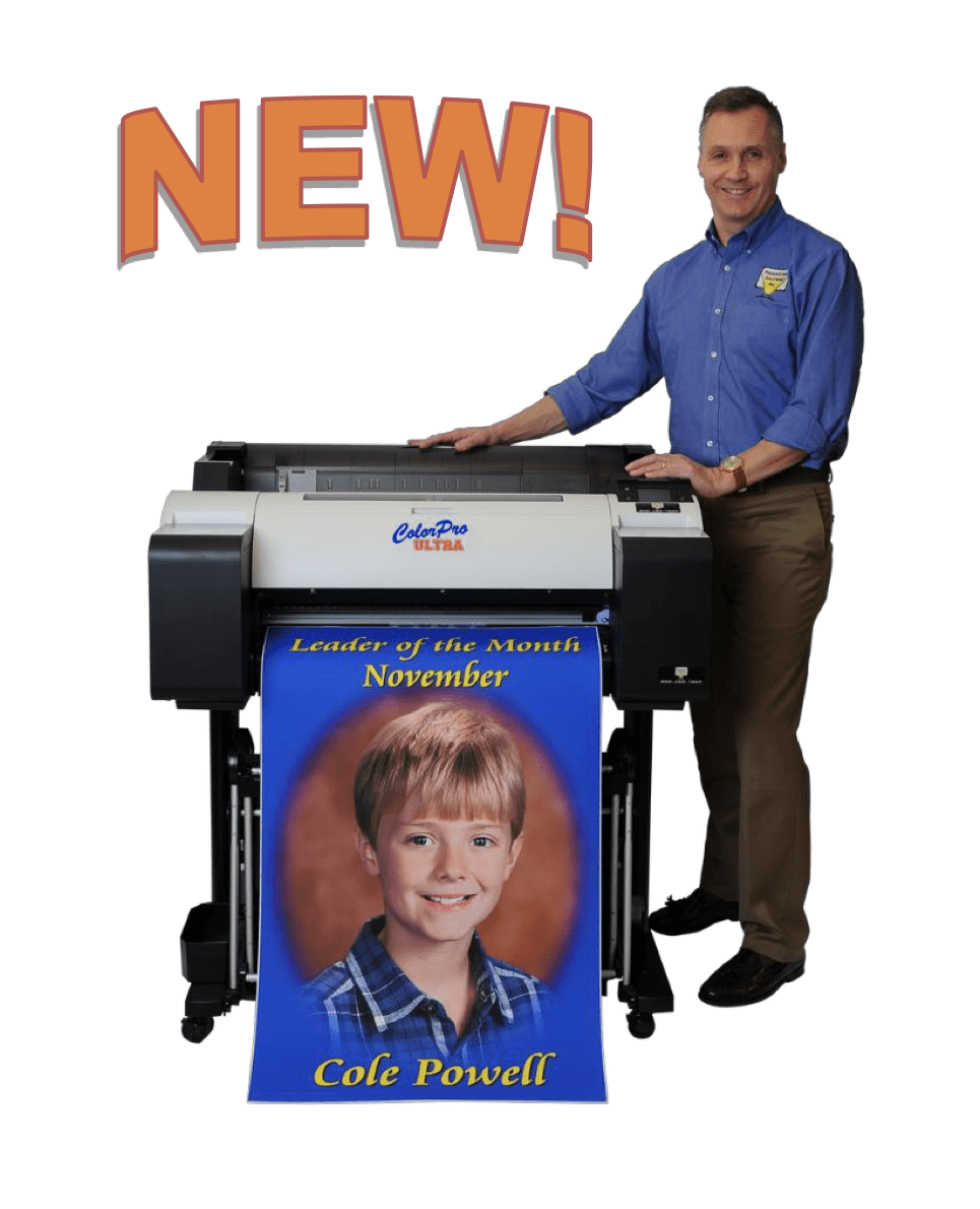 Joe Powell standing next to a color pro ultra post to maker
