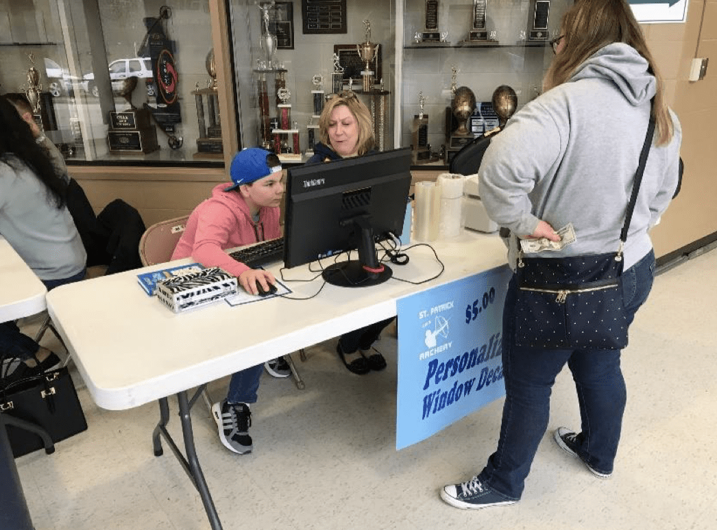 Students operating the recognizer for a school fundraiser